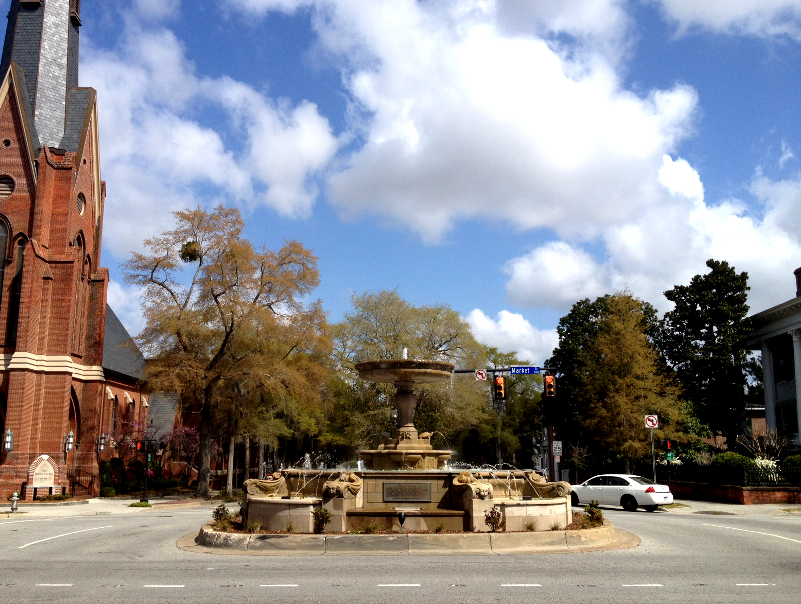 Kenan Fountain occupies the middle of the intersection of Fifth Avenue and Market Street in Wilmington. Port City Daily file photo.
