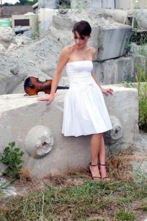 UNCW professor and professional violinist Danijela Žeželj-Gualdi survived the civil wars of former Yugoslavia to find a life of music here in America.