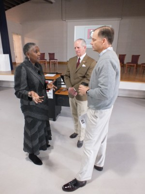Douglass Academy headmaster Barbra Jones, Roger Bacon Academy director Baker Mitchell, center, and New Hanover County Board of Commissioners Chairman Woody White talk charter schools during a tour of the Sixth Street facility Friday. Photos by Hilary Snow.