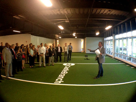 CastleBranch founder and CEO Brett Martin unveils the company's astroturf room in its new corporate headquarters in Wilmington. Photo by Ben Brown.