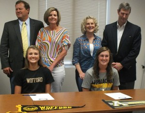 Rebecca McLean, right, and Brooke Graham pose for a picture with family on Wednesday.