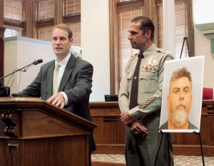 District Attorney Ben David, left, and New Hanover County Sheriff Ed McMahon, right, announced today that Larry Karl Gonzales was arrested last week in Texas and charged with first-degree murder in connection with the death of Alton Corey Vann in January 2009. Photo by Christina Haley.