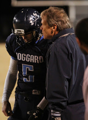 Scott Braswell, right, talks with quarterback Austin Shoenleber during a game in 2014.