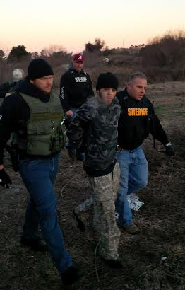 Deputies take William Earl Hewett into custody. Photo courtesy of the BCSO.