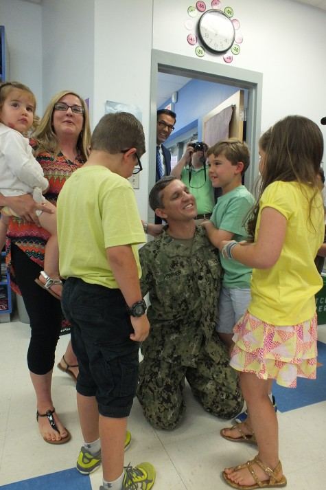 Andreas Heppner, center, reunites with his triplets, Chris, Maggie and Cooper at Anderson Elementary Thursday as his wife, Leslie, and daughter, Charlie, look on. Photos by Hilary Snow.
