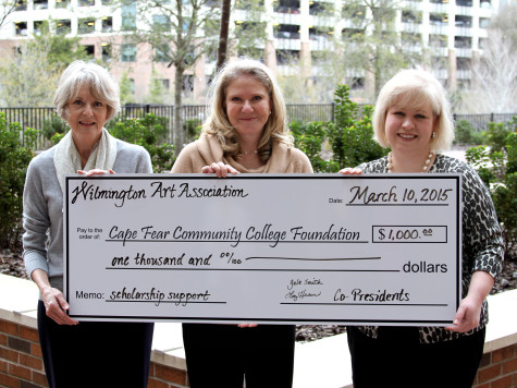 Wilmington Art Association co-Presidents Liz Hosier and Gale Smith present a check for scholarships to Dana McKoy, CFCC Director of Annual Giving. Photo courtesy CFCC.