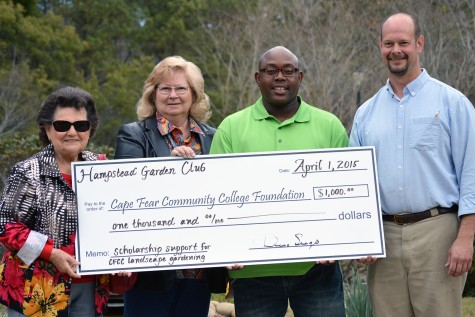 From left, Hampstead Garden Club vice-president Val Trofimoff and president Dena Seago present a scholarship to CFCC student Jeffrey Marshall, pictured here with landscape gardening instructor Ken Wells. Photo courtesy CFCC.