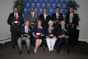 Front row, from left-to-right: Moyer Smith, Phyllis Miller, representing Joe Miller; Judy Holley, representing Jack Holley; and Dave Odom; back row: Chris Norman, Ralph Holloway;NCHSAA Commissioner Davis Whitfield, who introduced each inductee; Rick Strunk and Jerry Winterton. Photo courtesy- John Bell