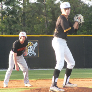 Bryce Cota, right, gets the sign as Ward Coleman leads off second.