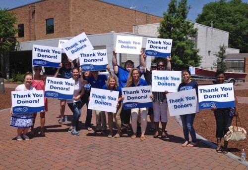 CFCC students greet guests at the recent Gift of Education luncheon with 'Thank You' signs. Attendees helped raise $300,000 this year for scholarships. Photo courtesy CFCC.
