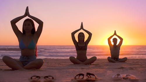 Tamara Yoga offers an early morning beach yoga session this Friday. Photo courtesy Tamara Yoga.