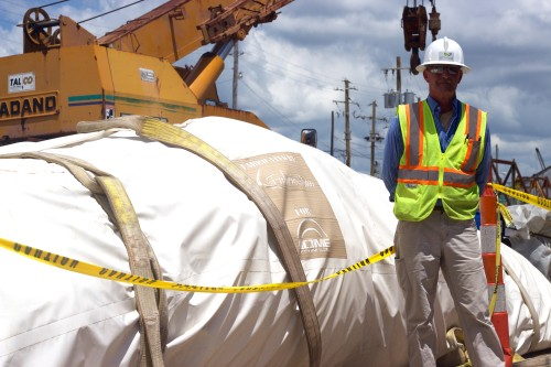 Willie Bordeaux, a site coordinator for Enviva, stands next to the bagged dome before it's inflation.