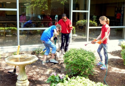 Leland Middle School students work on a school garden. Photo courtesy CIS of Brunswick County.