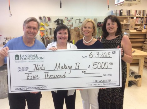 Carol Drury, Olaf Preston and Tammy Darazsdi of the Landfall Foundation present the grant award to Kids Making It. Courtesy photo.