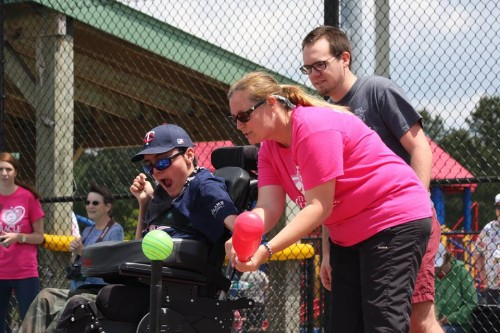 """Through the help of volunteer """"buddies,"""" the league allows children and adults with a wide range of special needs play baseball."""