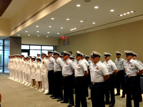 The crew of the U.S. Coast Guard Cutter Diligence receive orders from their new commander.