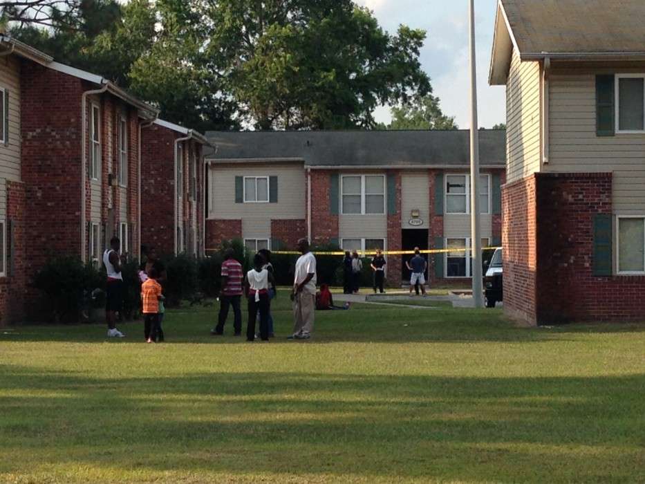 Investigators with the Wilmington Police Department processing the scene of a shooting at Greentree Apartments on Wednesday. Photo by Christina Haley.