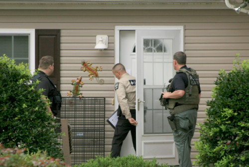 Deputies check a sex offender registered at an address in Supply. Photo by Christina Haley.
