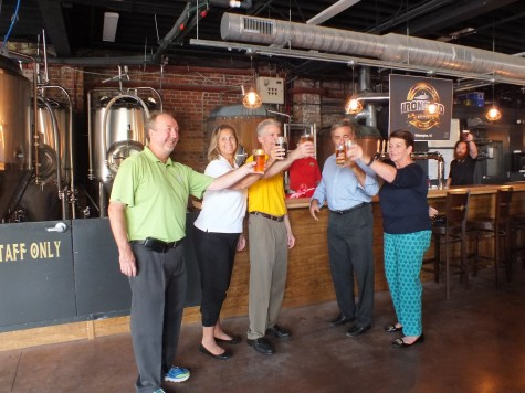 From left, Ed Wolverton of Wilmington Downtown, Inc., Ironclad Brewing owners Michelle and Ted Coughlin, Wilmington mayor Bill Saffo and mayor pro tem Margaret Haynes celebrate the official opening of Ironclad Friday. Photo by Hilary Snow.