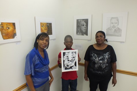 Jemerit Bryant, center, his mother, Toccara Bellamy, left, and grandmother Elma Cosley are featured in a multi-generational art exhibit. Photos by Hilary Snow.
