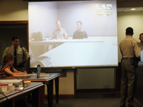 Joseph LeBlanc (right) made his first appearance in New Hanover County District Court by video. Photo by Christina Haley.