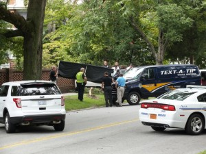 Wilmington police shield from onlookers the car in which a man was found fatally shot. Photo by Christina Haley, Port City Daily.