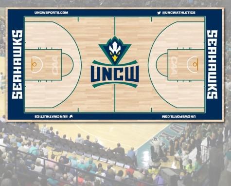 The floor at Trask Coliseum has a new design heading into basketball season. Photo courtesy- UNCW Sports