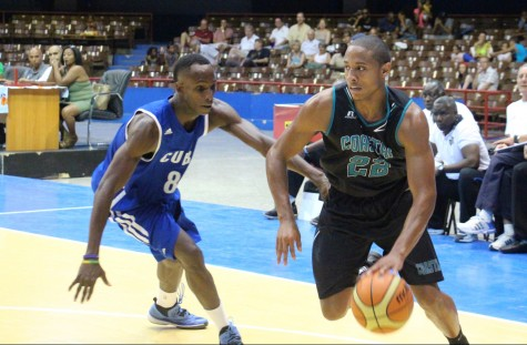 Elijah Wilson drives to the hole during a game in Cuba.
