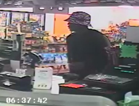 Wilmington police are searching for the identity of the man in this photo, who is suspected of an armed robbery at a gas station. Photo from surveillance courtesy of the Wilmington Police Department.