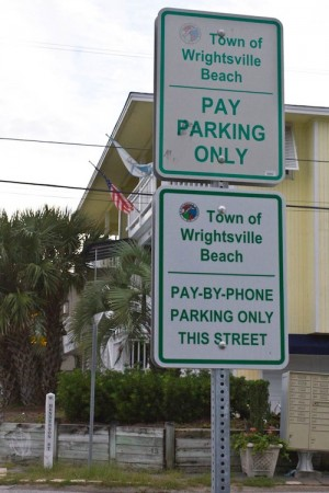 Parking signs on the corner of Lumina Ave. and W. Henderson St. in Wrightsville Beach. Photo by Hannah Leyva.