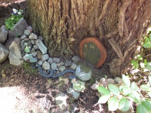 The Braswells give a nod to their daughter's love of Harry Potter with their 'Wee Potters' home at the base of a tree. Photo by Hilary Snow.