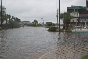 Carolina Beach Lake overflowed Monday morning due to high tides and heavy rain that fell overnight, causing Lake Park Boulevard to be closed down. Photo by Hannah Leyva