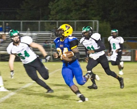 Laney's Jamius Becket carries the ball during Fridays game against West Brunswick. Photo by Hannah Leyva