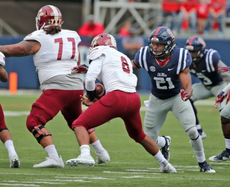 Terry Caldwell, right, made his first start for the Rebels on Saturday. Photo courtesy- Ole Miss Athletics