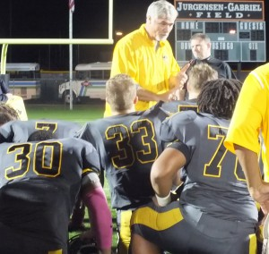 Topsail Coach Wayne Inman addresses his team after the game.