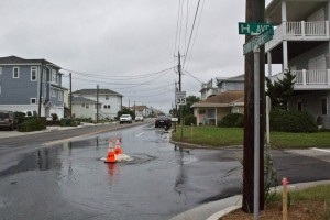 Water gushing out of a manhole at H Avenue and Fort Fisher Boulevard in Kure Beach in October 2015. Photo by Hannah Leyva.