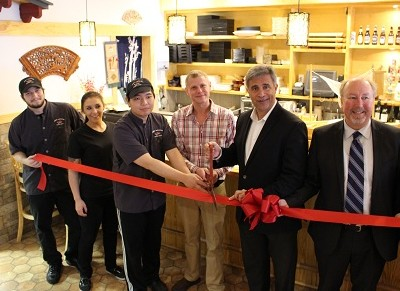 From left, Nikki's employees and general manager Jimmy Valimont celebrate a ribbon cutting ceremony with mayor Bill Saffo and Ed Wolverton of Wilmington Downtown Inc.
