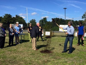 Wilmington Mayor Bill Saffo, second from right, and Vertex Railcar Corp. CEO Don Croteau break ground on the community garden at Portia Mills Hines Park on Oct. 31, 2015.