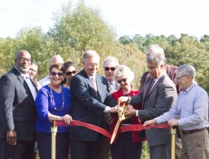Wilmington City Councilmembers and New Hanover County Commissioners joined Wilmington Mayor Bill Saffo (second from right) and BCBSNC President and CEO Brad Wilson (sixth from left) in a ribbon-cutting ceremony for the Gary Shell Cross-City Trail in Wade Park.