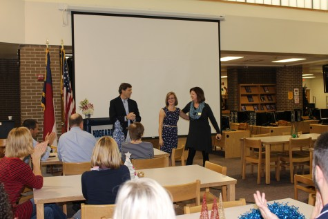 Cindi Rigsbee, right, from the N.C. Department of Public Instruction, and Superintendent Tim Markley helped deliver the news to Snyder to a crowd of her peers.