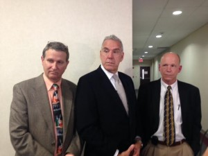 Members of Wilmington Plastic Surgery spoke with media after Wednesday's sentencing in an embezzlement case that stemmed from within their practice. Doctors Kenneth S. White, left, Charles R. Kays, and Jeffrey S. Church, hope business owners will learn from the case. Photo by Christina Haley.