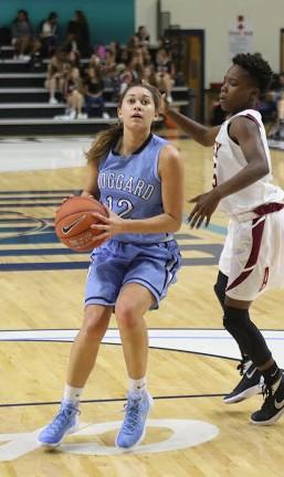 Alani Fisher drives to the basket. Photo courtesy- Rodney Williams