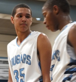 Andrew Mosely, left, talks it over with Quinton Reid during a timeout.