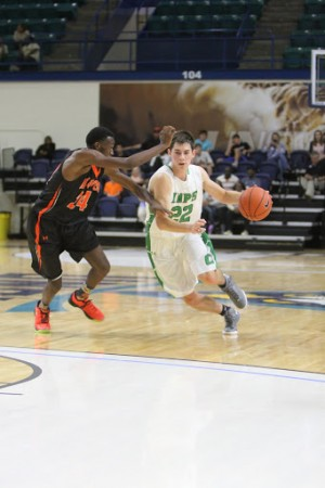 Cory Gensler drives to the basket for Cary. Photo courtesy Rodney Williams