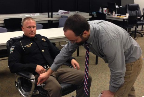 Robert Childs, with the N.C. Harm Reduction Coalition, administers a Naloxone dose to a sheriff's deputy during training. Photo by Christina Haley.