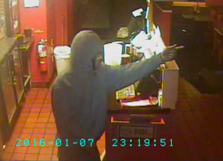 Police are searching for the suspect in this photo who reportedly robbed a Pizza Hut. Photo courtesy of a surveillance video provided by the police department.