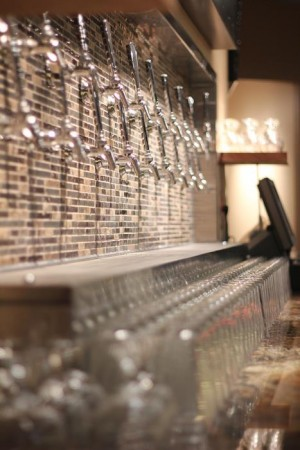 The upstairs bar, with adjoining patio, includes 19 craft beers from a custom-made tap system.
