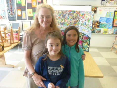 Carolina Beach Elementary students Elajandra Torres and Marea Bradley, seen here art teacher Melony Conner, were top winners in this year's Azalea Fest art contest. Courtesy photos.