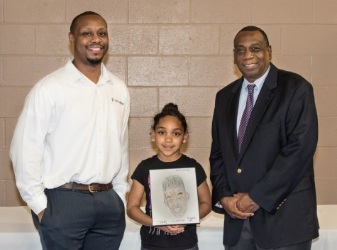 U.S. Cellulars Steven Westbrook, left, and Wilmington City Council member Earl Sherida pose with Jade Rivera, first place winner of this year's Black History Month art competition. Courtesy photos.
