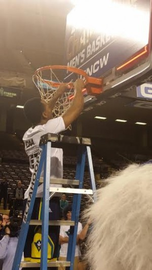 Senior Craig Ponder takes the first snip during the post game ceremony.